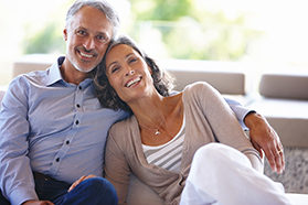 Portrait of an affectionate mature couple sitting inside together on the